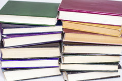 A pile of hardback books on a white background Stock Photos