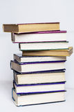 A pile of hardback books on a white background Royalty Free Stock Photography