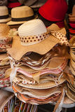Pile hats stacked on the market. Royalty Free Stock Photos