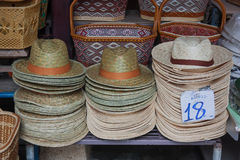 Pile hats stacked on the market. Stock Images
