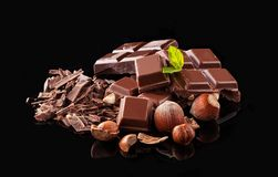 Pile of hazelnut chocolate on black background Stock Image