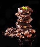 Pile of hazelnut chocolate on black background Royalty Free Stock Photography