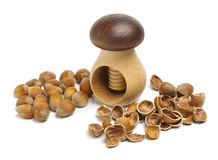 Pile of hazelnuts and broken shells Stock Images