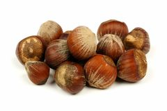 Pile of hazelnuts over white Royalty Free Stock Images