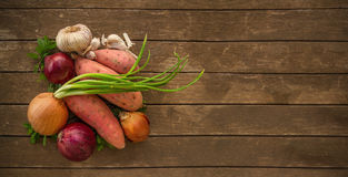 Pile of healthy vegetables on wood board Royalty Free Stock Image