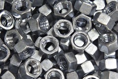 Pile Of Hex Nuts. A pile of zinc plated hex nuts stock photography