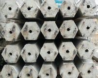 Pile of hexagon concrete foundation piles. Royalty Free Stock Image