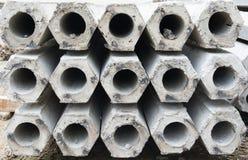 Pile of hexagon concrete foundation piles. Stock Photo