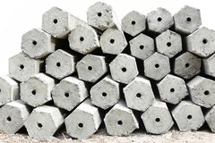 The pile of hexagon concrete foundation piles isolated. In white background Royalty Free Stock Photo