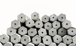 The pile of hexagon concrete foundation piles isolated. In white background Stock Image
