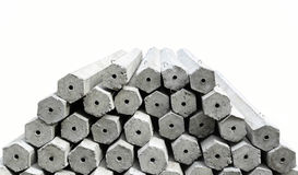 The pile of hexagon concrete foundation piles. In white background Royalty Free Stock Images