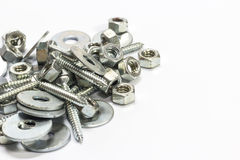 Pile of Hexagon nut and screw. And fender washer on white background Royalty Free Stock Images