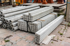 Pile of hexagon and square concrete foundation piles. Stock Photos