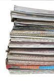 Pile high. A stack of magazines on white Royalty Free Stock Photography