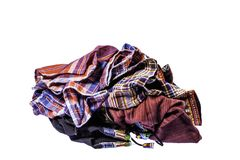The pile of hill tribe style clothes left. On white background with clipping path stock photo