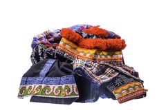 The pile of hill tribe style clothes left on white background. With clipping path stock image