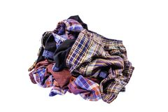 The pile of hill tribe style clothes left on white background. With clipping path stock photos