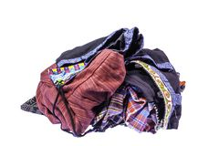 The pile of hill tribe style clothes left on white background. With clipping path stock photo