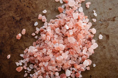 Pile of Himalayan pink salt. Top view on rusty metal background royalty free stock photo