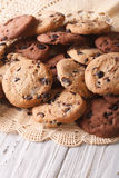 Pile of homemade chocolate chips cookies closeup, vertical Royalty Free Stock Photo