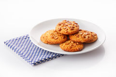 Pile of homemade peanut butter cookies on white ceramic plate on blue napkin Stock Photo
