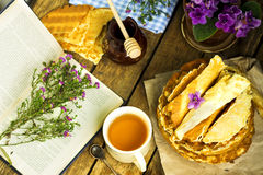 Pile of homemade wafers with book and honey stick Royalty Free Stock Images