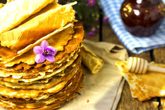 Pile of homemade wafers with honey stick Stock Photography