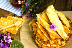 Pile of homemade wafers with honey stick Stock Images