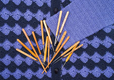Knitwear and crochet hooks Royalty Free Stock Image