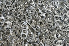 Pile of hoop can opener or pull ring as recycle, reuse again or. Green world concept Stock Images