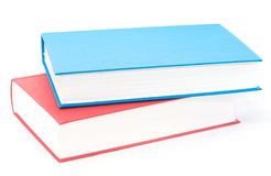 Pile horizontale de deux rouges et de livres bleus Images libres de droits