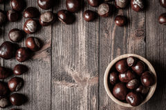 Pile of horse chestnuts in a bamboo bowl Royalty Free Stock Images