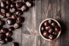 Pile of horse chestnuts in a bamboo bowl Stock Photos