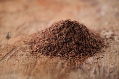 Pile of hot chocolate flakes  on wooden background Stock Image