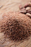 Pile of hot chocolate flakes  on wooden background Royalty Free Stock Images