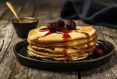 Pile of hot homemade yeast pancakes. Family breakfast Royalty Free Stock Photography