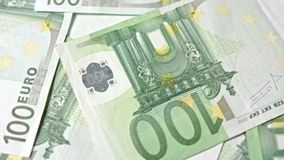 Pile of Hundred Euro Banknotes on a Table. A pile of hundred euro banknotes on a table. Close-up dolly shot Stock Image