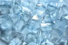 Pile of ice cubes. On color background royalty free stock photography
