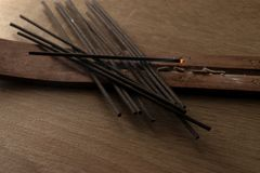 Pile of incense sticks on wooden background royalty free stock photo