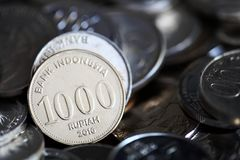Indonesian rupiah coins close up. Pile of Indonesian rupiah coins close up Stock Image