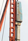 Pile installation by drop hammer. Stock Photos