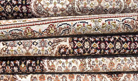 Persian carpet. A pile of Iranian carpets and rugs in a nice design in shop shelf Stock Photo