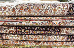 Persian carpet. A pile of Iranian carpets and rugs in a nice design in shop shelf Stock Photography