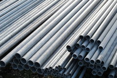 Pile of iron pipes for the transport of electrical cables and op Royalty Free Stock Photos