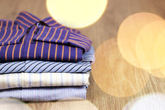 Pile of ironing shirts and hand Stock Photos