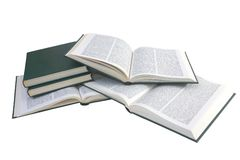 Pile of isolated books. Pile of opened green books with a plain text in two columns Royalty Free Stock Images