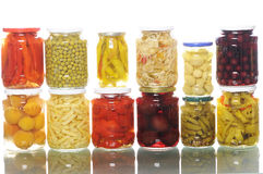Pile of jars with asorted pickles Stock Photo