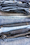 Pile of jeans. Close up of a pile of different jeans to use as a background Royalty Free Stock Photos