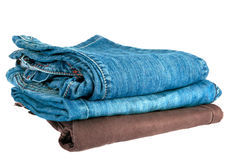 Pile of jeans. Isolated on white Stock Photo