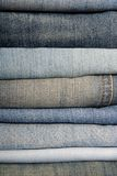 A pile of jeans. It is a close up of pile of jeans Stock Photos